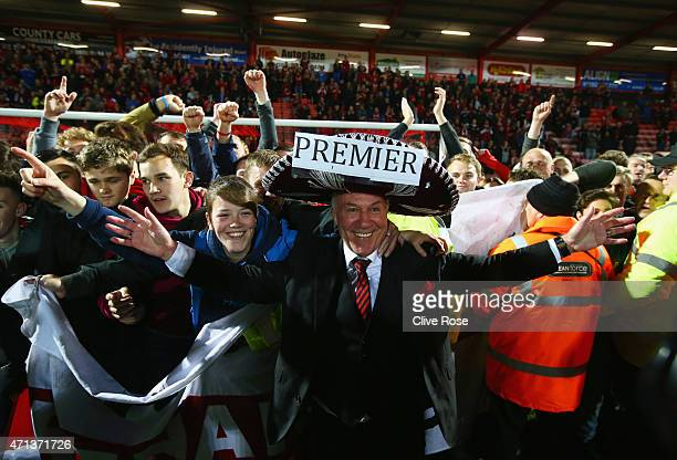 Bournemouth chairman Jeff Mostyn and fans celebrate victory on the pitch after the Sky Bet Championship match between AFC Bournemouth and Bolton...