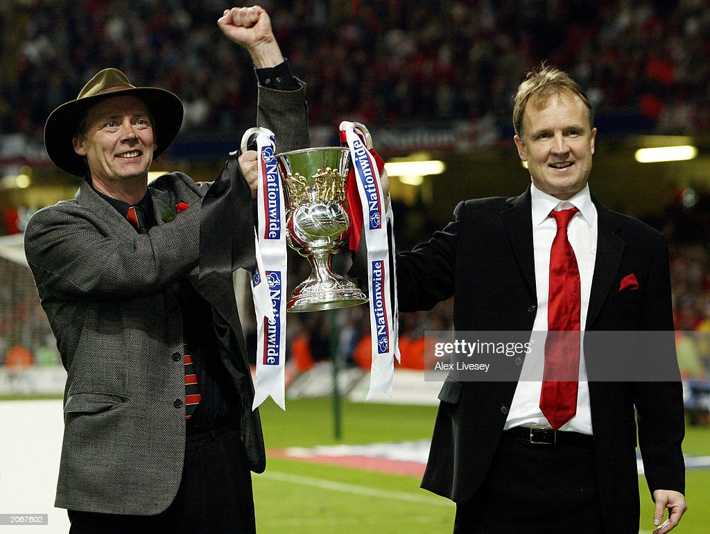 Bournemouth chairman Peter Phillips and Bournemouth manager Sean O'Driscoll celebrate with the trophy after the Nationwide division three playoff final match between AFC Bournemouth and Lincoln City on May 24, 2003 at the Millennium Stadium in Cardiff, Wales. AFC Bournemouth won the match 5-2.
