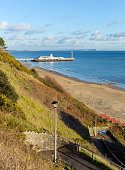 Bournemouth beach pier and coast Dorset England UK near to Poole known for beautiful sandy beaches with blue sky in this popular tourist destination in the English south