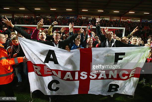 Bournemouth fans celebrate victory on the pitch after the Sky Bet Championship match between AFC Bournemouth and Bolton Wanderers at Goldsands...