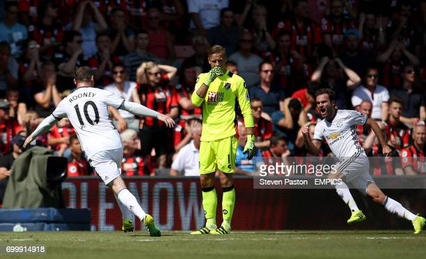 AFC Bournemouth goalkeeper Artur Boruc looks on as Manchester United's Juan Mata celebrates scoring his side's first goal of the game with Manchester...