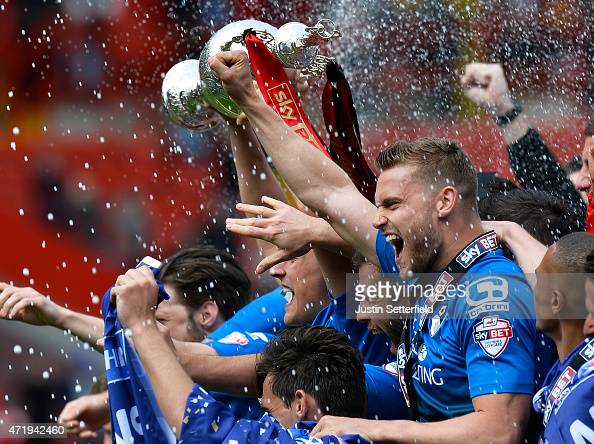 Bournemouth lift the Championship trophy after winning the the Sky Bet Championship after the game between Charlton Athletic and AFC Bournemouth at...