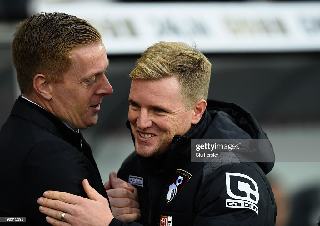 Bournemouth manager Eddie Howe and Garry Monk embrace before the Barclays Premier League match between Swansea City and AFC Bournemouth at Liberty...