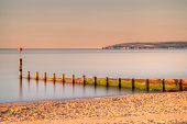 'Early morning light over Bournemouth Beach with Old Harry in the distance, England'
