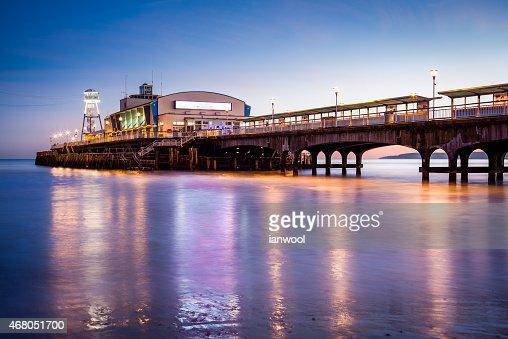 Bournemouth Pier at night Dorset : Stock Photo