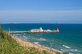 View of Bournemouth Pier from West Cliff, looking towards Boscombe, the Isle of Wight and Hengistbury Head, Dorset.