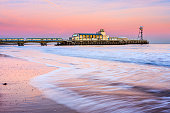 Bournemouth pier at Sunset from beach Dorset England UK Europe