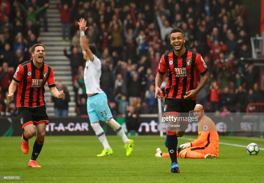 Bournemouth player Dan Gosling (l) and Joshua King celebrates King's second goal during the Premier League match between AFC Bournemouth and West Ham United at Vitality Stadium on March 11, 2017 in Bournemouth, England.