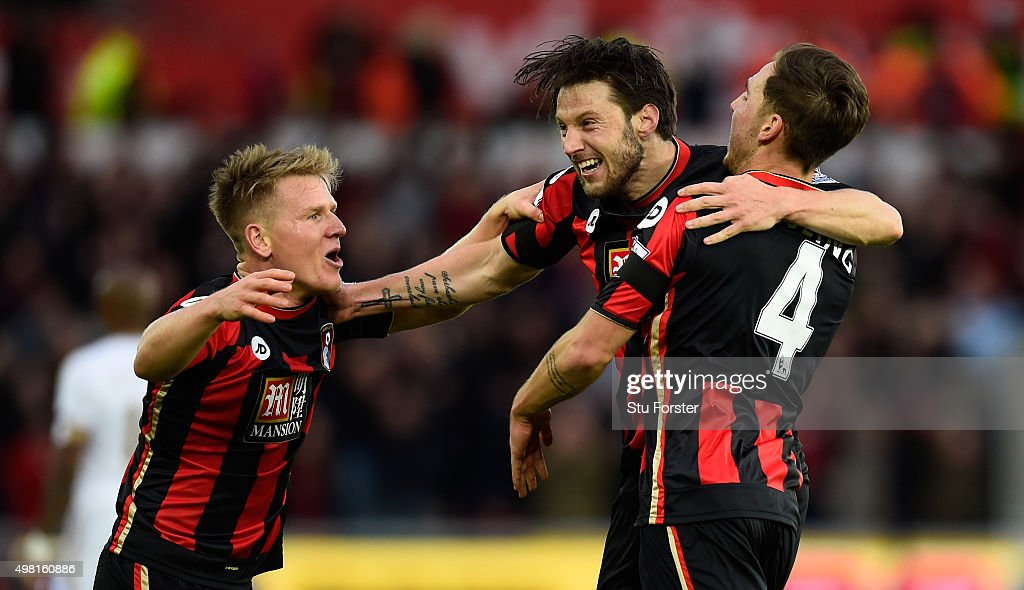 Bournemouth player Dan Gosling celebrates his first goal with Matt Ritchie and Harry Arter during the Barclays Premier League match between Swansea...