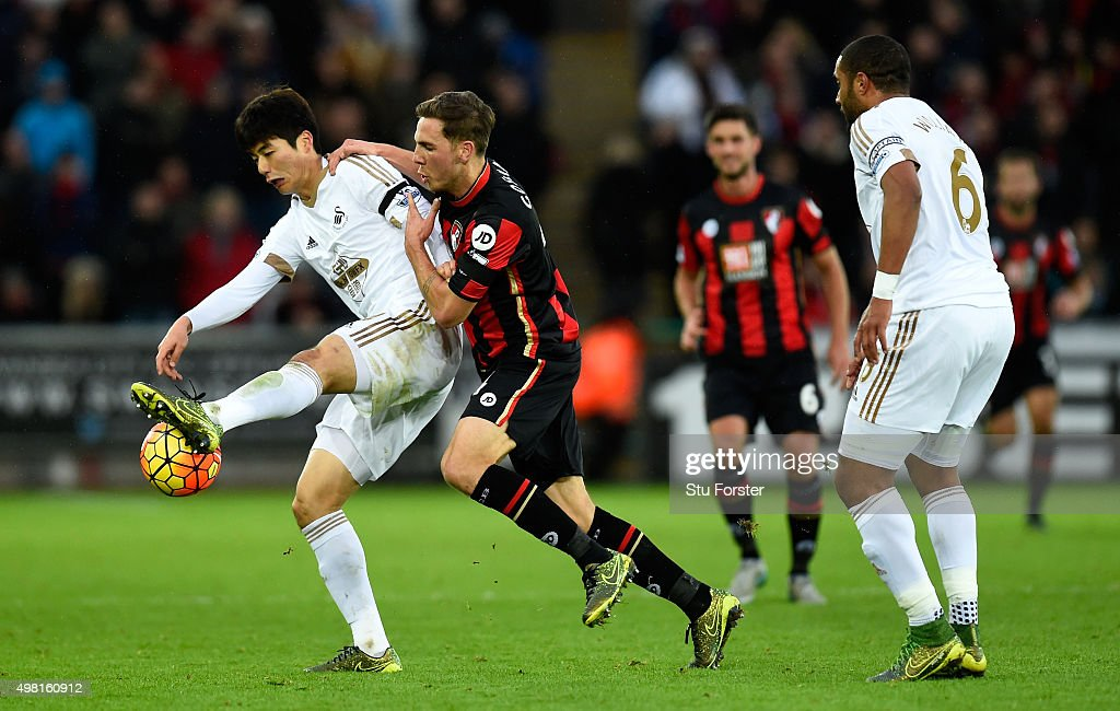 Bournemouth player Dan Gosling challenges Ki SungYueng during the Barclays Premier League match between Swansea City and AFC Bournemouth at Liberty...