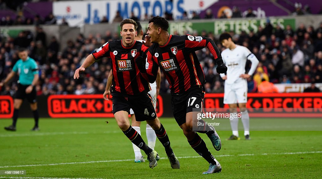 Bournemouth player Joshua King and Dan Gosling celebrate the opening goal during the Barclays Premier League match between Swansea City and AFC...