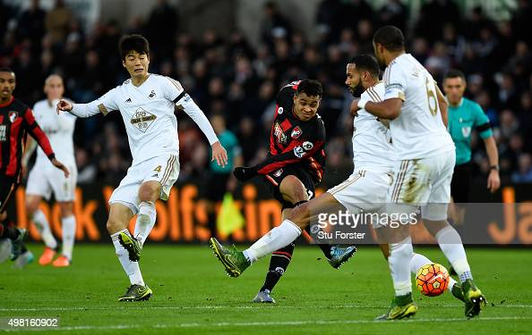 Bournemouth player Joshua King shoots at goal during the Barclays Premier League match between Swansea City and AFC Bournemouth at Liberty Stadium on...