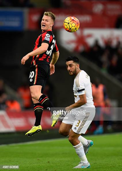Bournemouth player Matt Ritchie rises above Neil Taylor during the Barclays Premier League match between Swansea City and AFC Bournemouth at Liberty...