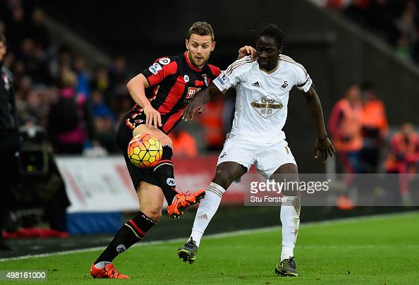Bournemouth player Simon Francis challenges Eder of Swansea during the Barclays Premier League match between Swansea City and AFC Bournemouth at...