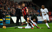 Bournemouth player Simon Francis is challenged by Ashley Williams of Swansea during the Barclays Premier League match between Swansea City and AFC...