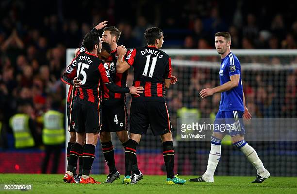 Bournemouth players Adam Smith Junior Stanislas Dan Gosling and Charlie Daniels celebrate their 10 win while Gary Cahill of Chelsea leaves the pitch...