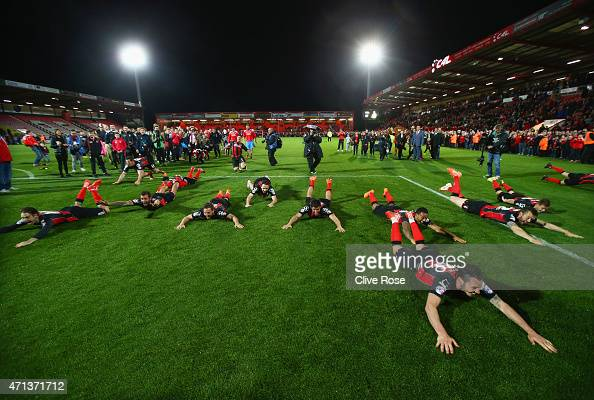 Bournemouth players celebrate victory on the pitch after the Sky Bet Championship match between AFC Bournemouth and Bolton Wanderers at Goldsands...