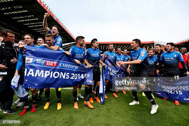 Bournemouth players celebrate winning the Championship after the Sky Bet Championship match between Charlton Athletic and AFC Bournemouth at The...