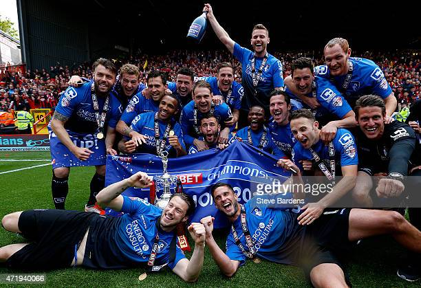 Bournemouth players celebrate with the trophy after winning the Championship during the Sky Bet Championship match between Charlton Athletic and AFC...