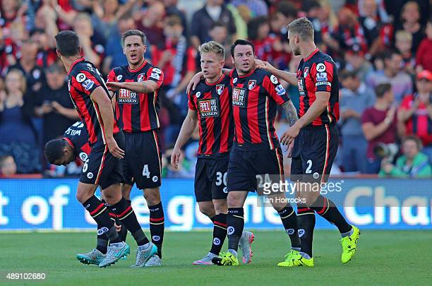 Bournemouth players surround Matt Richie after he scored Bournemouth's second goal during the Barclays Premier League match between Bournemouth and...