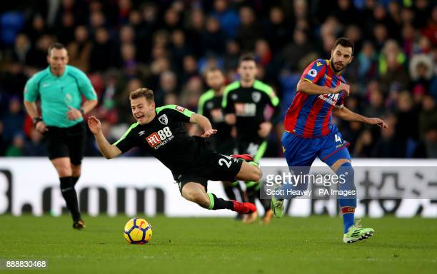 Bournemouth Ryan's Fraser is upended by Crystal Palace's Luka Milivojevic during the Premier League match at Selhurst Park London
