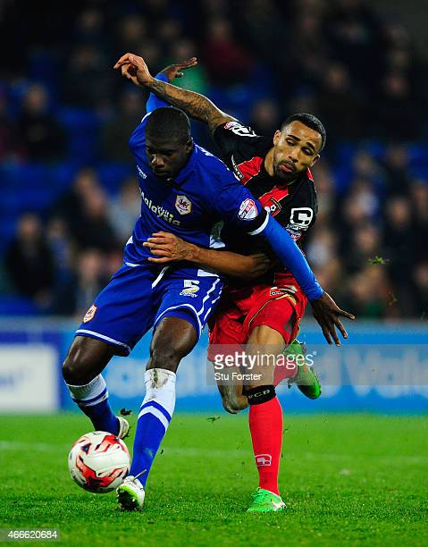Bournemouth striker Callum Wilson is foiled by Cardiff defender Bruno Ecuele Manga during the Sky Bet Championship match between Cardiff City and AFC...