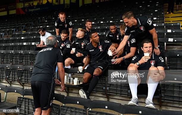 Bournemouth striker Callum Wilson serves tea to his team mates before the Pre season friendly match between Exeter City and AFC Bournemouth at St...