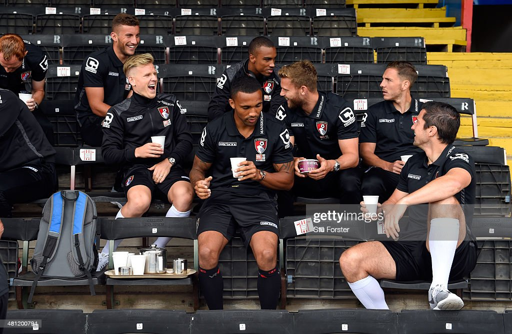 Bournemouth striker Matt Ritchie (l) enjoys a laugh with team mates as tea is served before the Pre season friendly match between Exeter City and AFC Bournemouth at St James Park on July 18, 2015 in Exeter, England.
