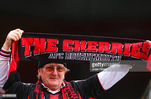 Bournemouth supporter holds up his scarf ahead of the FA Cup Fourth Round match between Bournemouth and Liverpool at Goldsands Stadium on January 25...