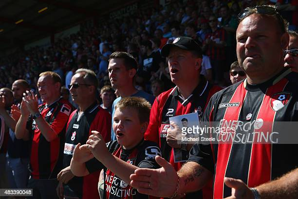 Bournemouth supporters cheer during the Barclays Premier League match between AFC Bournemouth and Aston Villa at Vitality Stadium on August 8 2015 in...