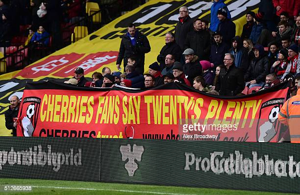 Bournemouth supporters hold a banner protesting at ticket prices during the Barclays Premier League match between Watford and AFC Bournemouth at...