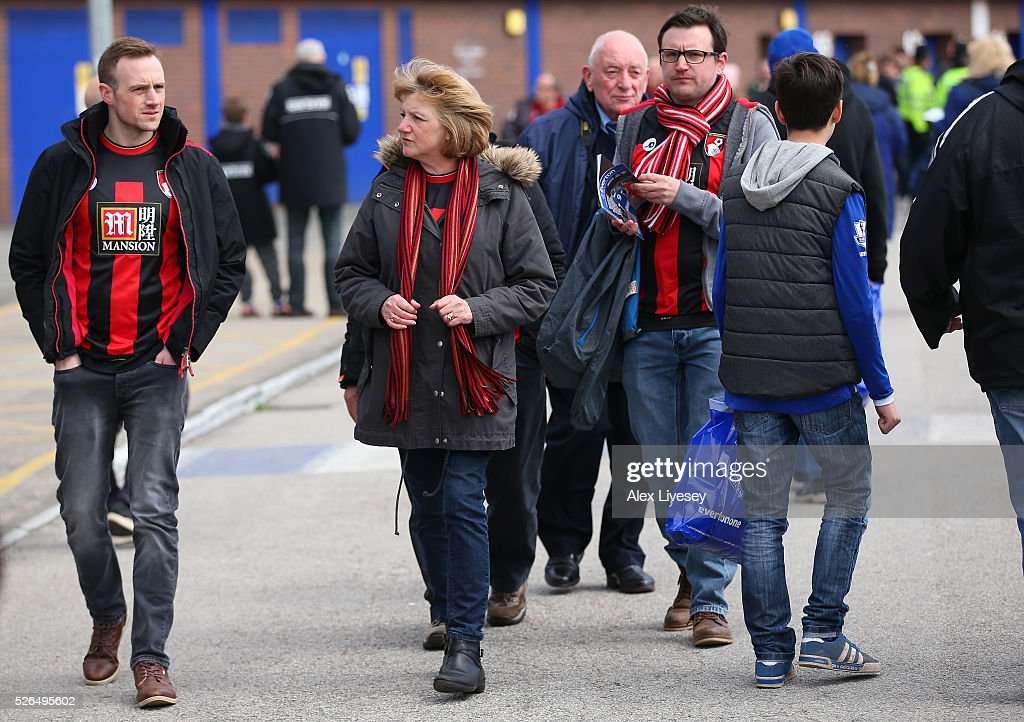 Bournemouth supporters make their way to the stadium prior to the Barclays Premier League match between Everton and A.F.C. Bournemouth at Goodison Park on April 30, 2016 in Liverpool, England.