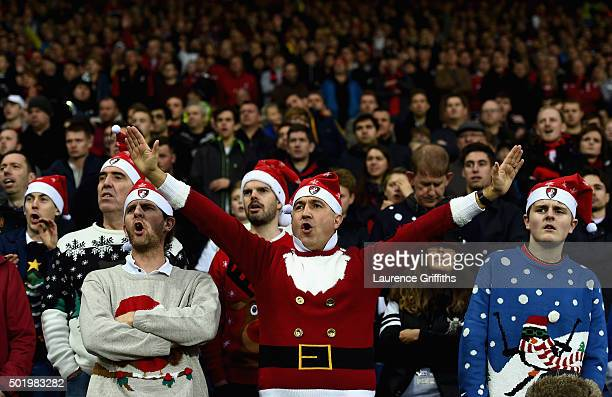 Bournemouth supporters wearing Christmas jumpers cheer during the Barclays Premier League match between West Bromwich Albion and AFC Bournemouth at...