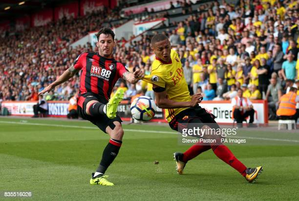 AFC Bournemouth's Adam Smith and Watford's Richarlison battle for the ball during the Premier League match at the Vitality Stadium Bournemouth