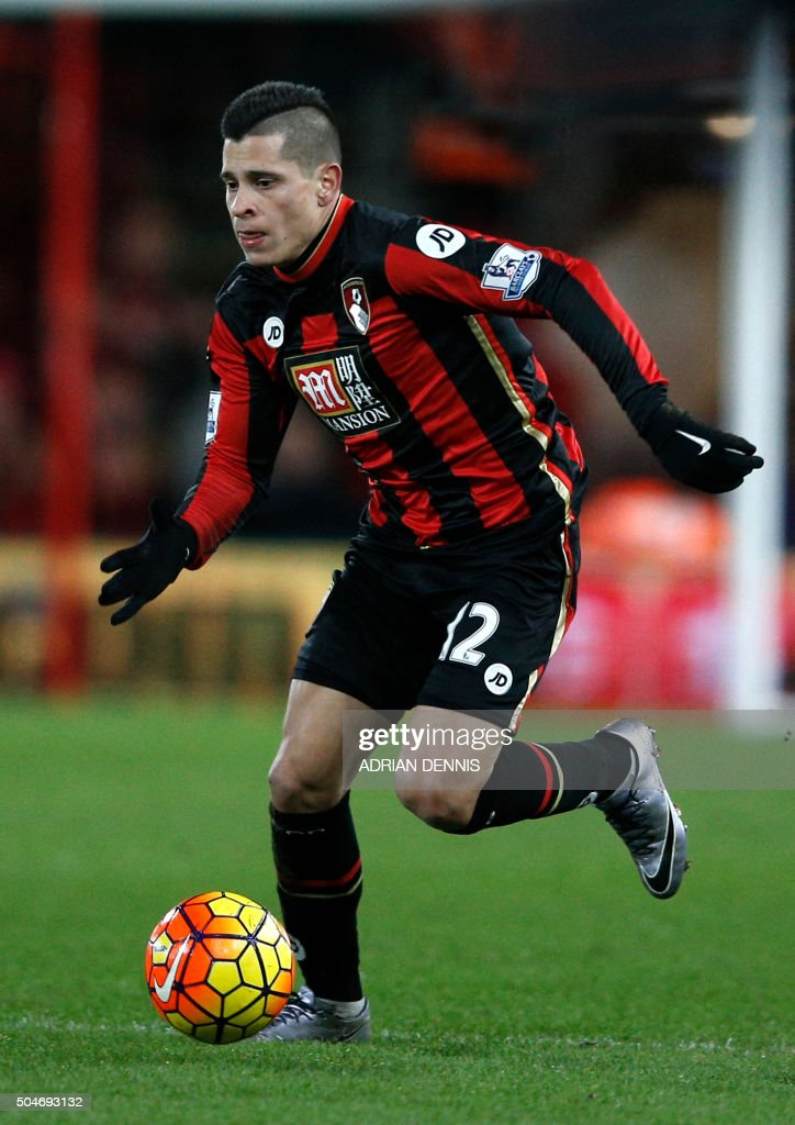 Bournemouth's Argentinian midfielder Juan Iturbe runs with the ball during the English Premier League football match between Bournemouth and West Ham United at the Vitality Stadium in Bournemouth, southern England on January 12, 2016. AFP PHOTO / ADRIAN DENNIS USE. No use with unauthorized audio, video, data, fixture lists, club/league logos or 'live' services. Online in-match use limited to 75 images, no video emulation. No use in betting, games or single club/league/player publications. / AFP / ADRIAN