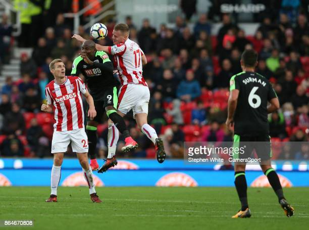 Bournemouth's Benik Afobe battles with Stoke City's Darren Fletcher and Ryan Shawcross during the Premier League match between Stoke City and AFC...