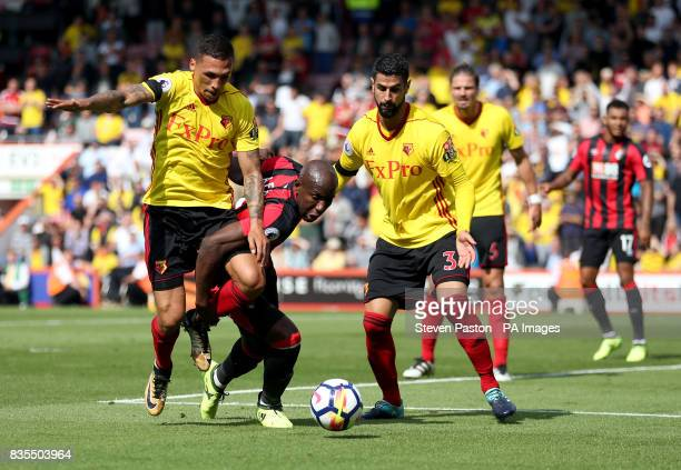 AFC Bournemouth's Benik Afobe goes down in the area under the challenge from Watford's Jose Holebas during the Premier League match at the Vitality...