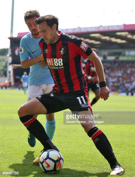 AFC Bournemouth's Charlie Daniels and Manchester City's Bernado Silva in action during the Premier League match at the Vitality Stadium Bournemouth