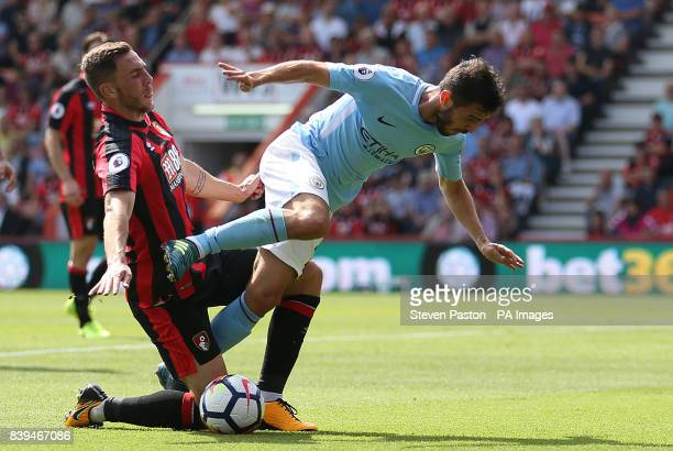 AFC Bournemouth's Dan Gosling and Manchester City's Bernado Silva battle for the ball during the Premier League match at the Vitality Stadium...