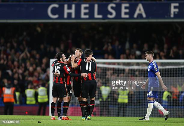 Bournemouth's English defender Adam Smith and Bournemouth's English midfielder Charlie Daniels celebrate with teammates after the English Premier...