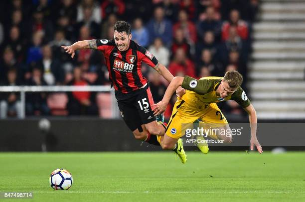 TOPSHOT Bournemouth's English defender Adam Smith vies with Brighton's English midfielder Solly March during the English Premier League football...