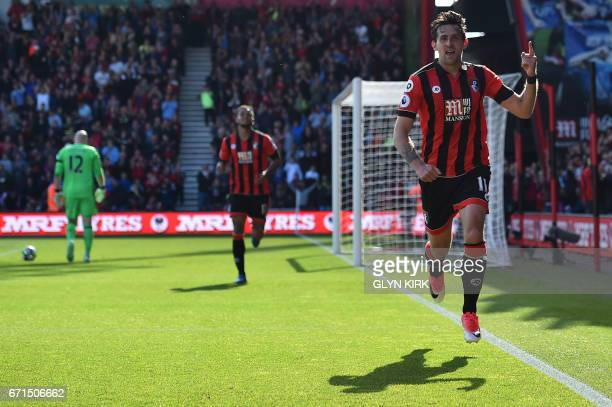 Bournemouth's English midfielder Charlie Daniels celebrates after scoring their fourth goal during the English Premier League football match between...