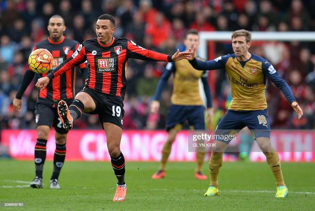 Bournemouth's English midfielder Junior Stanislas (L) controls the ball by Arsenal's Spanish defender Nacho Monreal during the English Premier League football match between Bournemouth and Arsenal at the Vitality Stadium in Bournemouth, southern England on February 7, 2016. / AFP / GLYN KIRK / RESTRICTED TO EDITORIAL USE. No use with unauthorized audio, video, data, fixture lists, club/league logos or 'live' services. Online in-match use limited to 75 images, no video emulation. No use in betting, games or single club/league/player publications. /