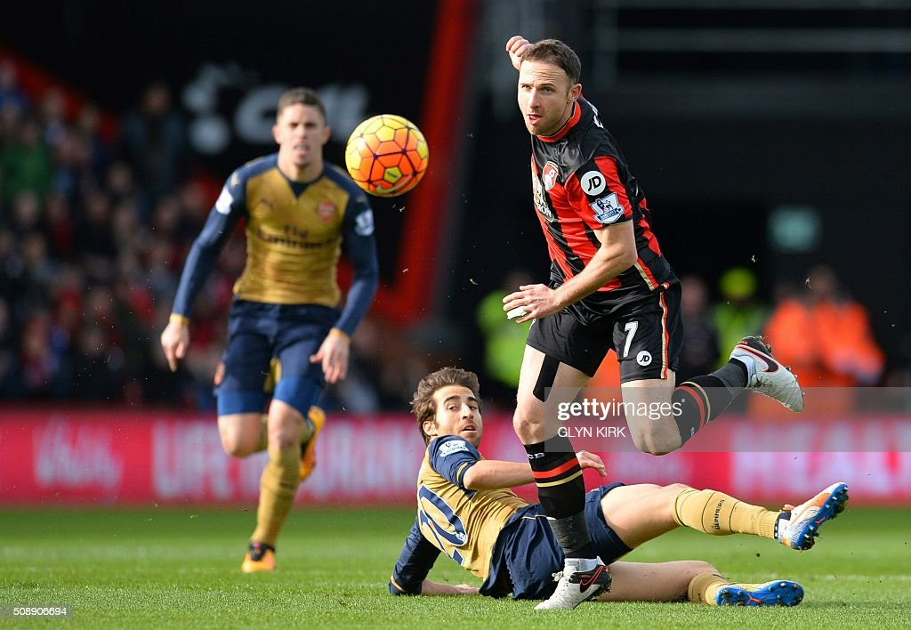 Bournemouth's English midfielder Marc Pugh (R) skips a tackle by Arsenal's French midfielder Mathieu Flamini during the English Premier League football match between Bournemouth and Arsenal at the Vitality Stadium in Bournemouth, southern England on February 7, 2016. / AFP / GLYN KIRK / RESTRICTED TO EDITORIAL USE. No use with unauthorized audio, video, data, fixture lists, club/league logos or 'live' services. Online in-match use limited to 75 images, no video emulation. No use in betting, games or single club/league/player publications. /