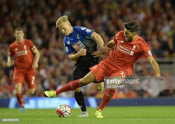 Bournemouth's English midfielder Matt Ritchie challenges Liverpool's German midfielder Emre Can during the English Premier League football match...