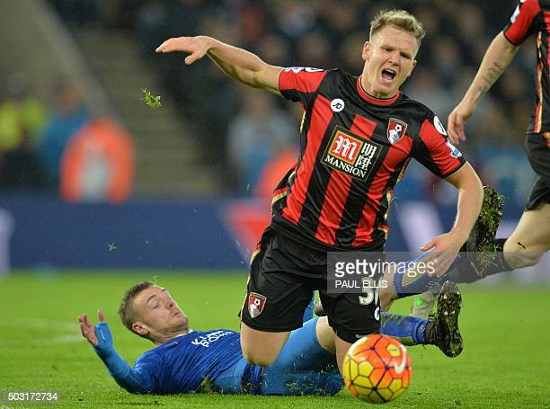 Bournemouth's English midfielder Matt Ritchie is tackled by Leicester City's English striker Jamie Vardy during the English Premier League football...