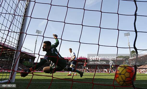 Bournemouth's English midfielder Matt Ritchie scores his early goal past Tottenham Hotspur's French goalkeeper Hugo Lloris during the English Premier...