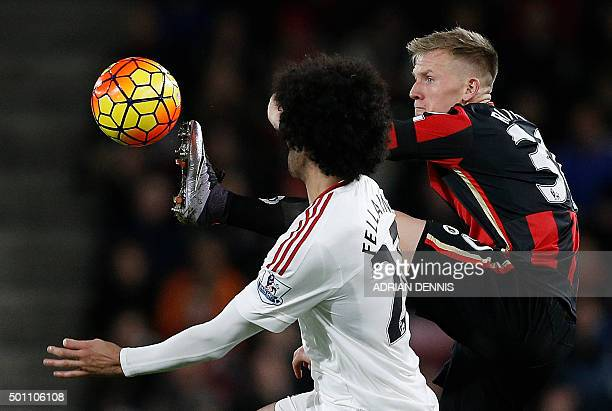 Bournemouth's English midfielder Matt Ritchie vies with Manchester United's Belgian midfielder Marouane Fellaini during the English Premier League...