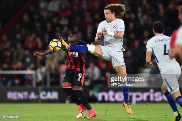 Bournemouth's English striker Benik Afobe vies with Chelsea's Brazilian defender David Luiz during the English Premier League football match between...