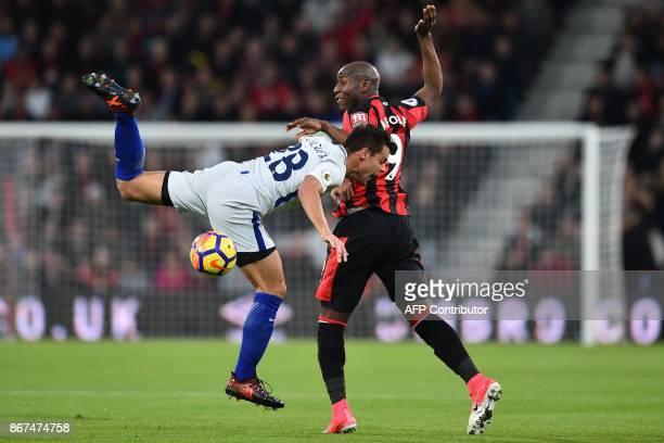 Bournemouth's English striker Benik Afobe vies with Chelsea's Spanish defender Cesar Azpilicueta during the English Premier League football match...